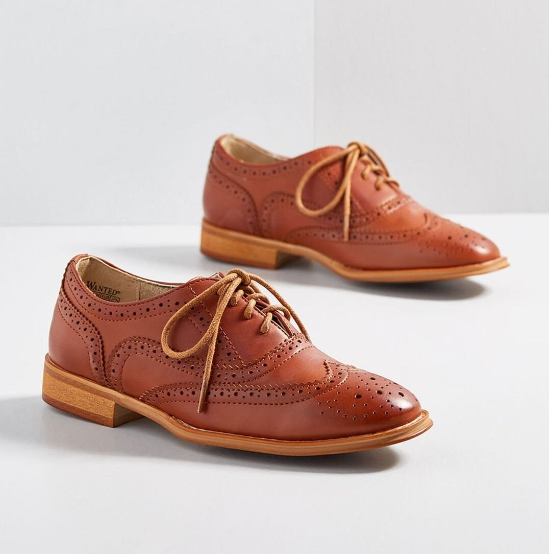 those shoes in a chestnut brown color laced up in the front and with detailed perforations throughout