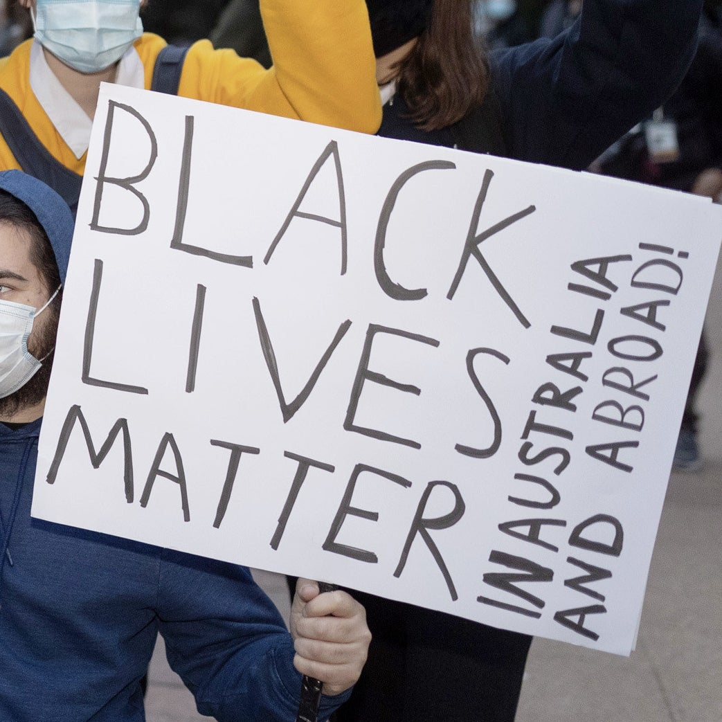 "A protest sign reads ""Black lives matter, in Australia and abroad""."