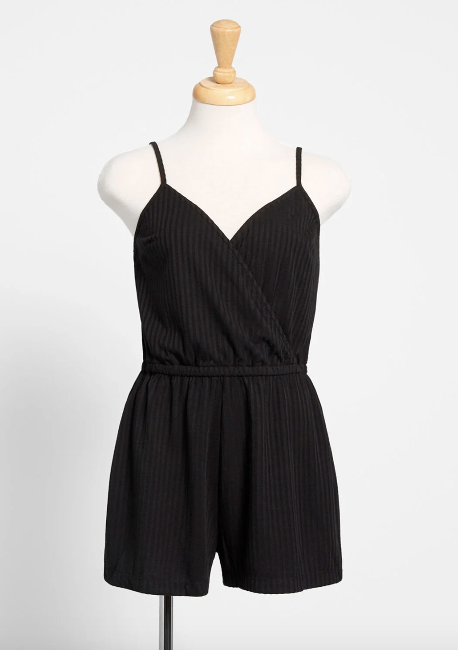 A black romper with shorts on top, straps, and V-neckline