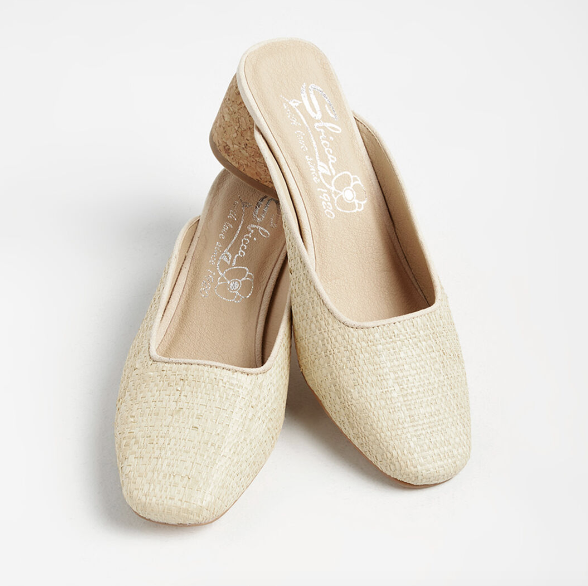 A pair of low-heeled ivory woven mules