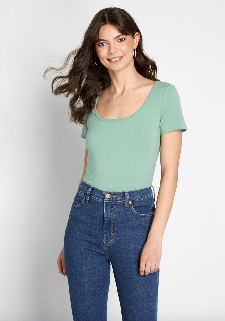 A model in a short-sleeved mint green top