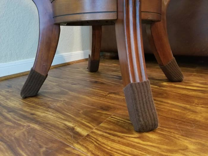 Reviewer image of brown furniture socks on table legs