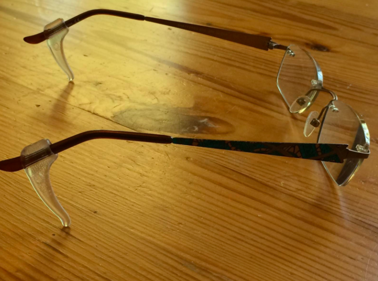 A customer review photo of the Keepons on their glasses.