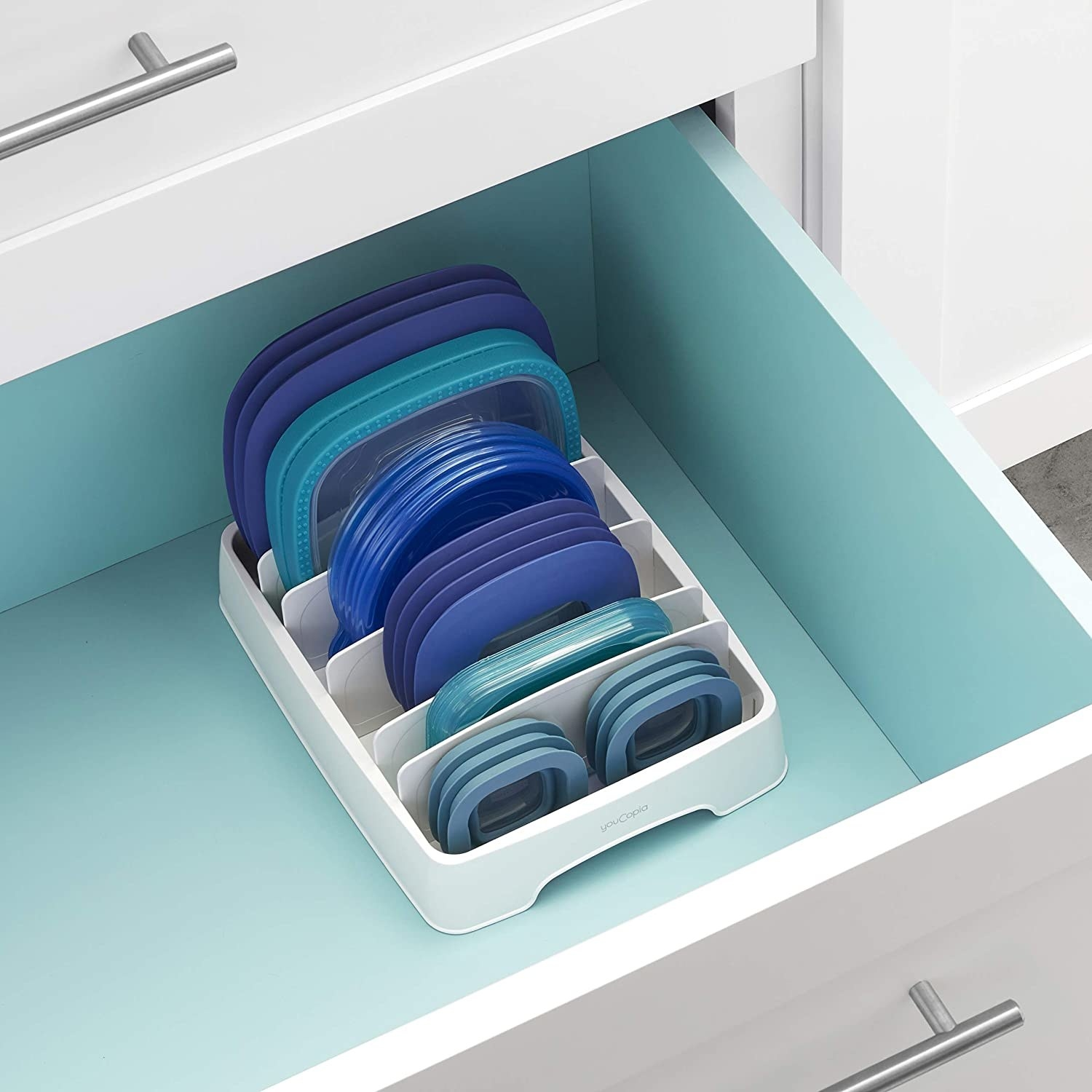 A variety of lids securely stored in the lid organizer.