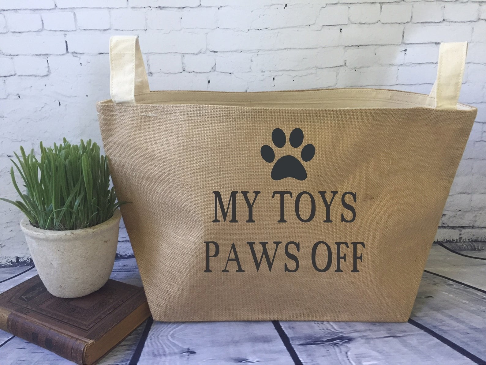 """Basket with handles printed with a pawprint and the text """"my toys paws off"""""""