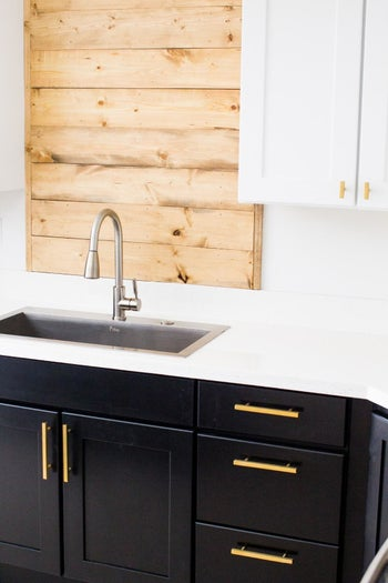 black cabinets and drawers with the pulls