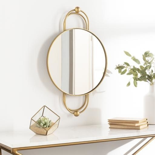 round mirror with u-shaped embellishments on top and bottom with circular charms
