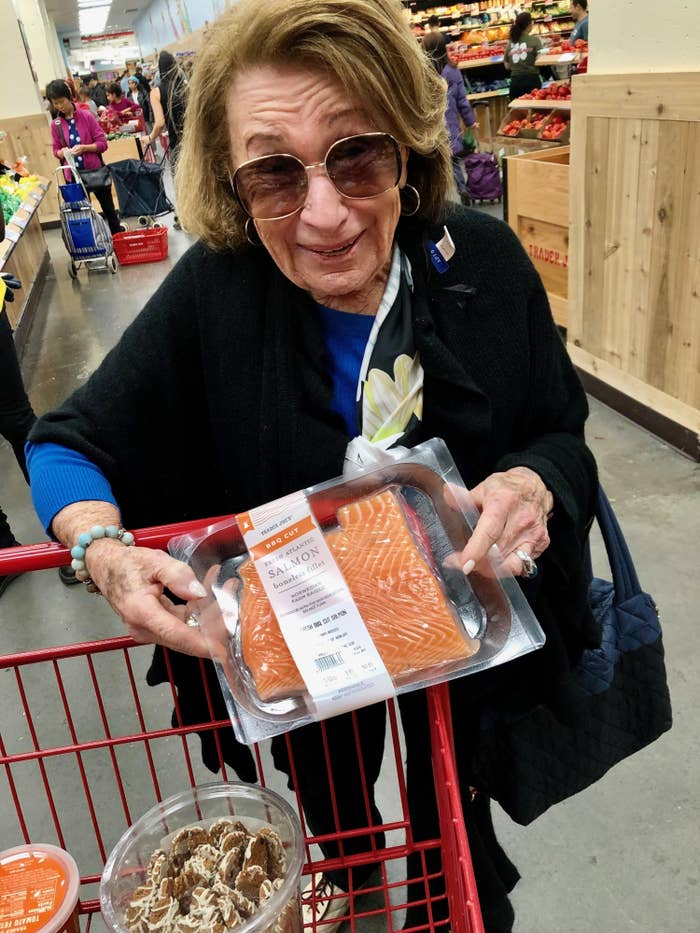 My grandmother grocery shopping at Trader Joe's, showing me one of her favorite items, the BBQ-cut salmon.