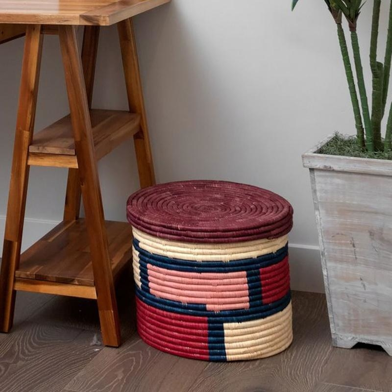The burgundy, beige, pink, and dark blue basket with lid