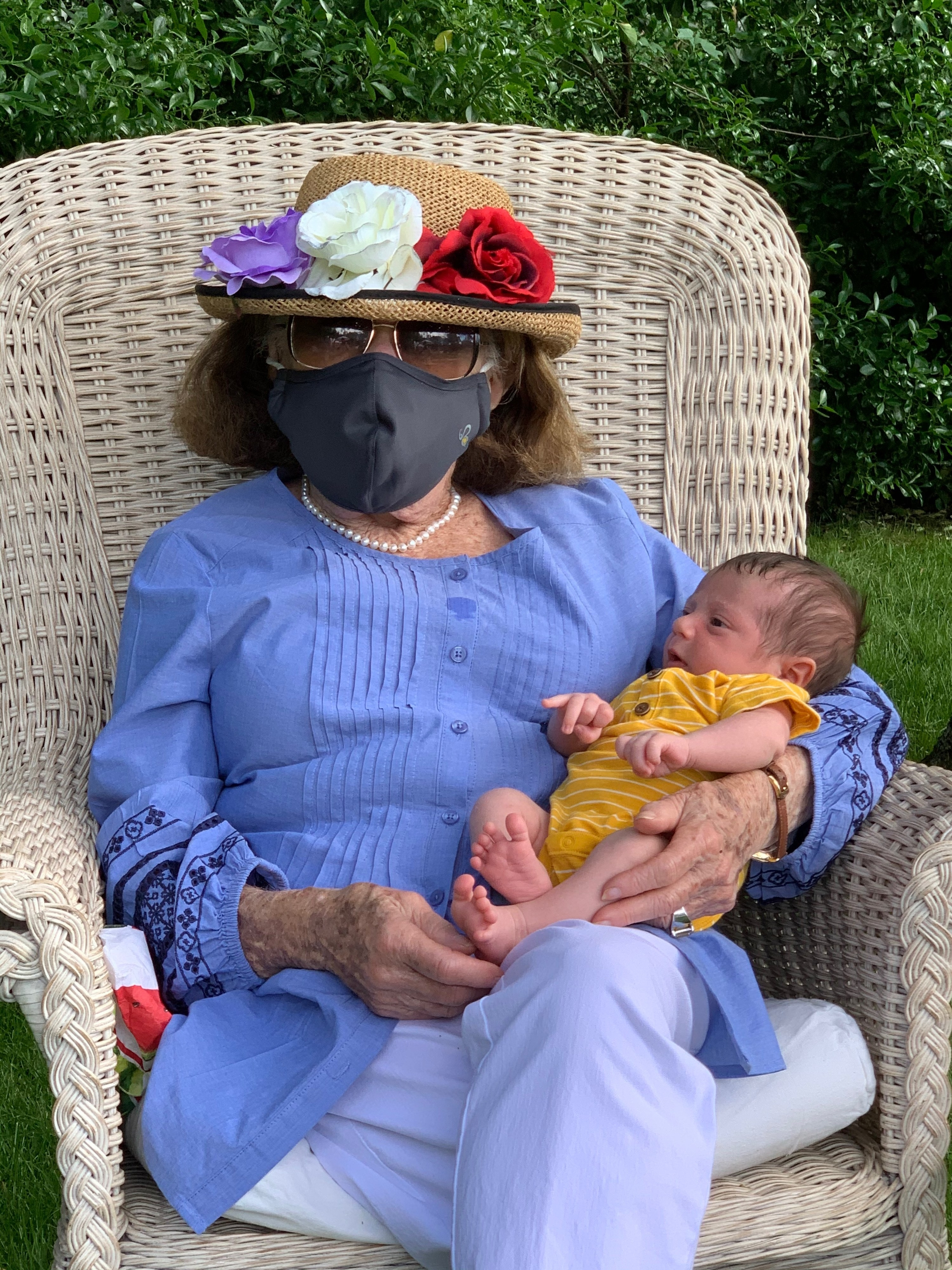 My grandmother holding her great grandson for the first time, wearing a mask!