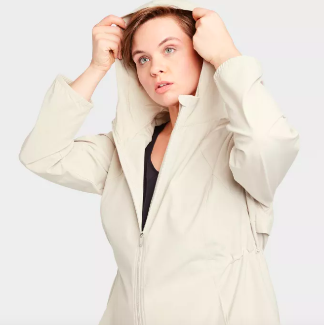 Model wears white lightweight zip jacket with a hood and pockets