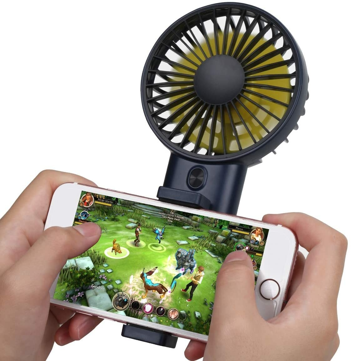 A person playing a game on their phone with the fan attached
