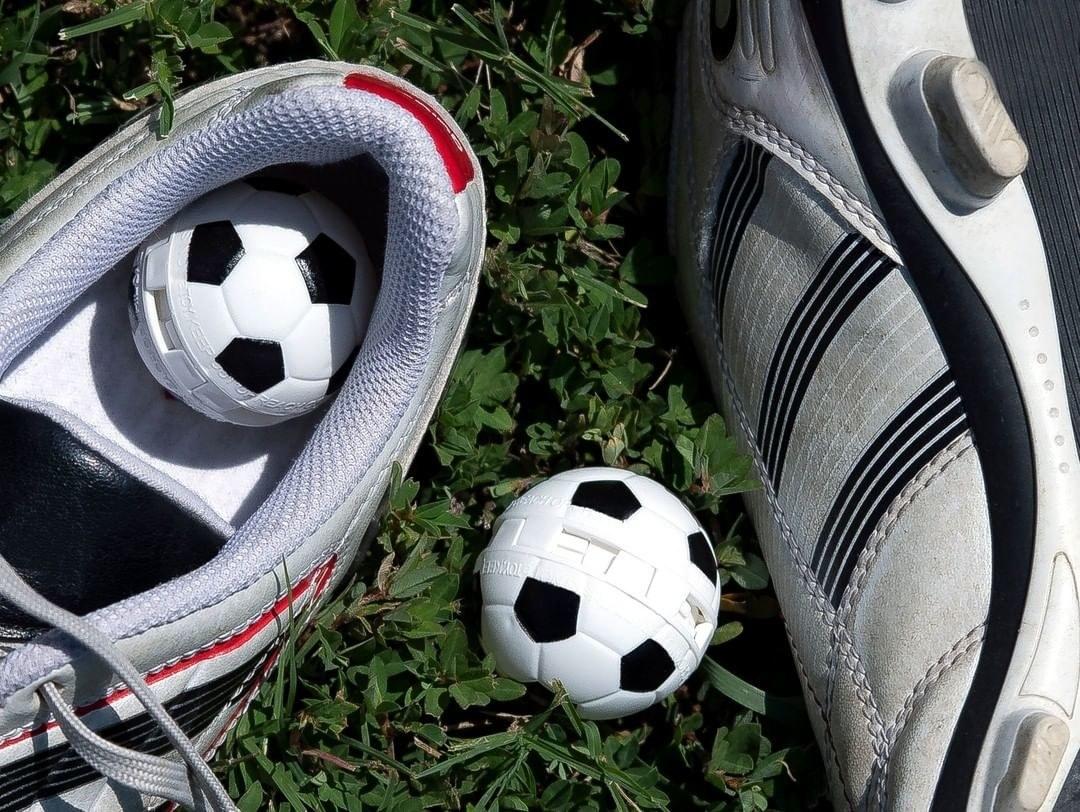 A pair of soccer Sneaker Balls inside soccer cleats