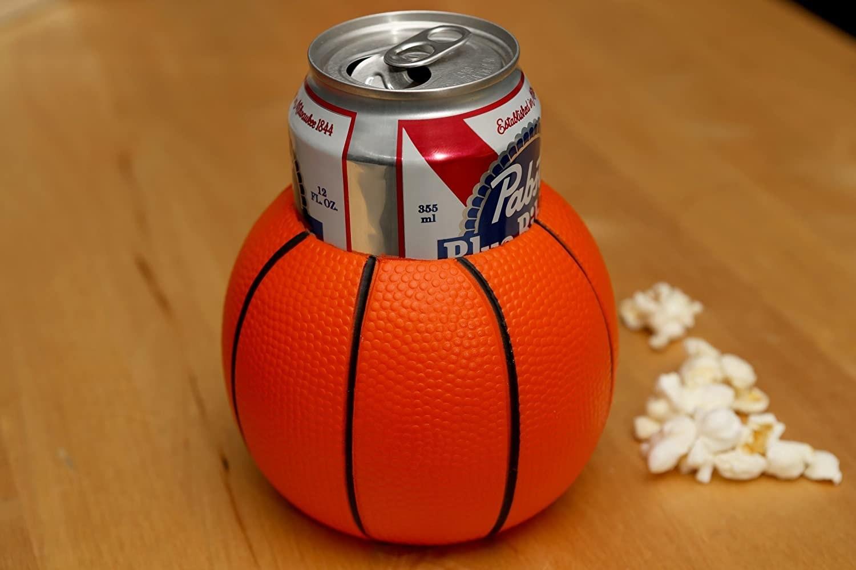 A basketball beverage holder with a drink inside