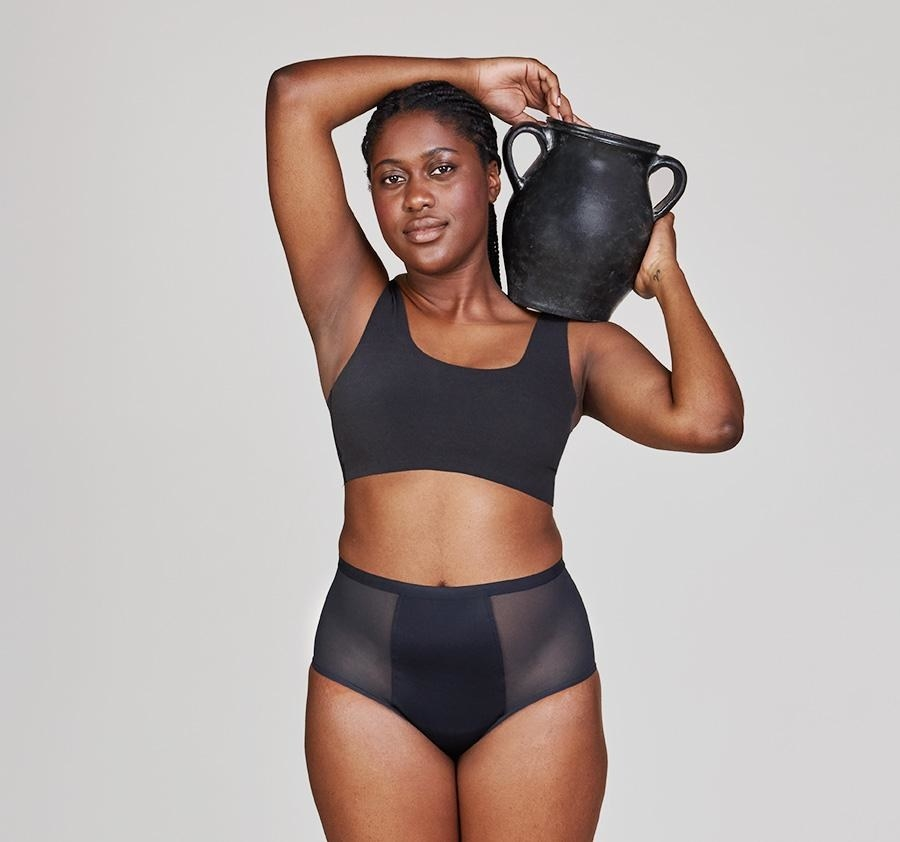 A model wearing the high waisted bottoms. They are mesh on either side and hit right at the bellybutton.