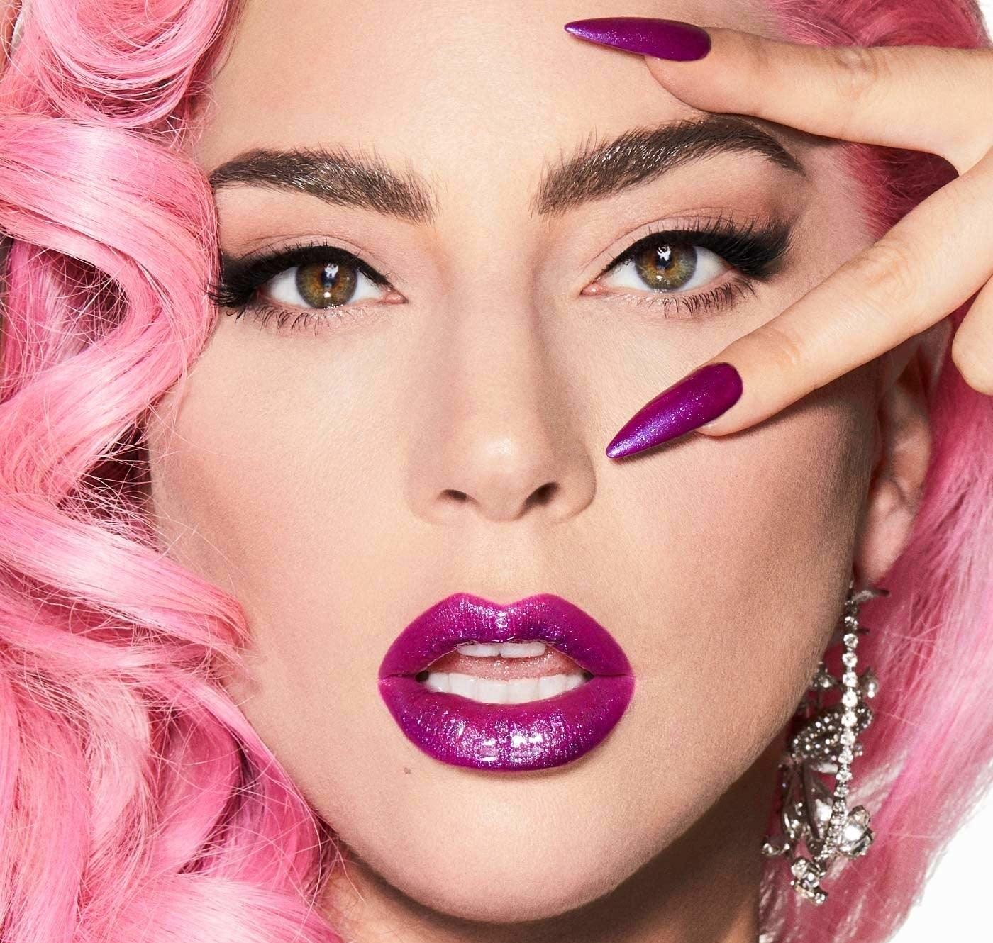 lady gaga wearing bright purple tinted lip gloss