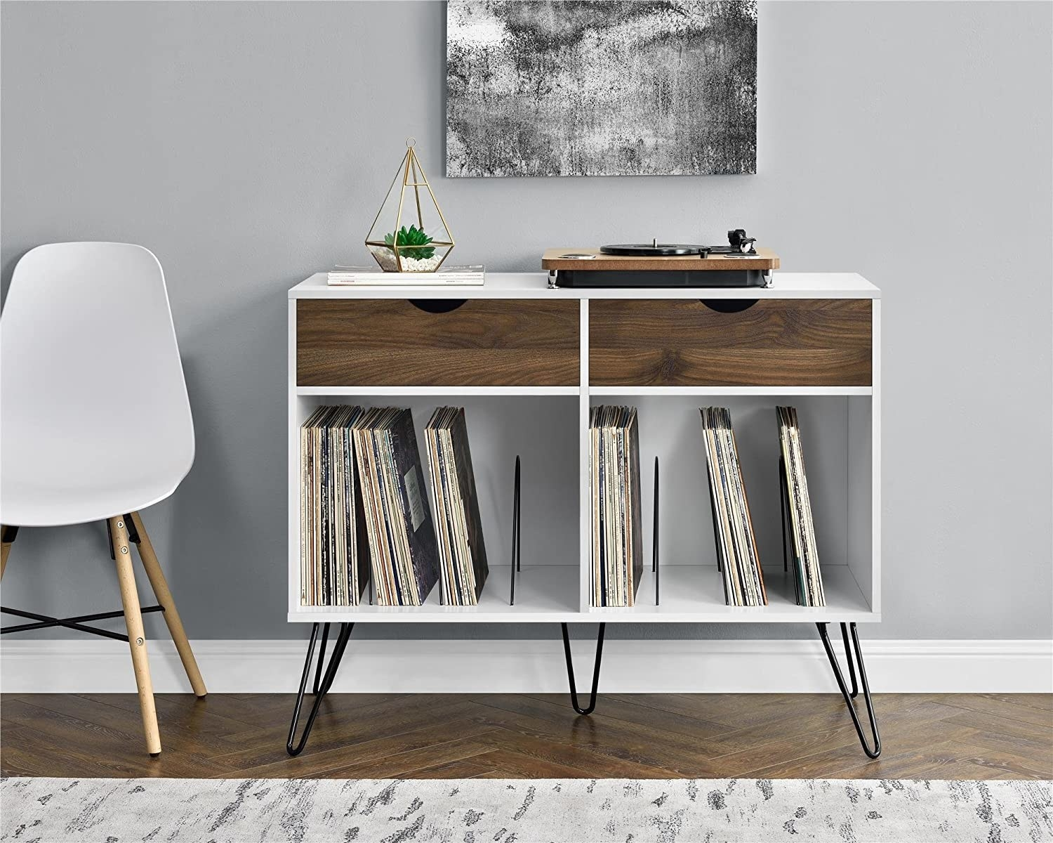 console with hairpin legs, two drawers, and two open spaces with record dividing wires