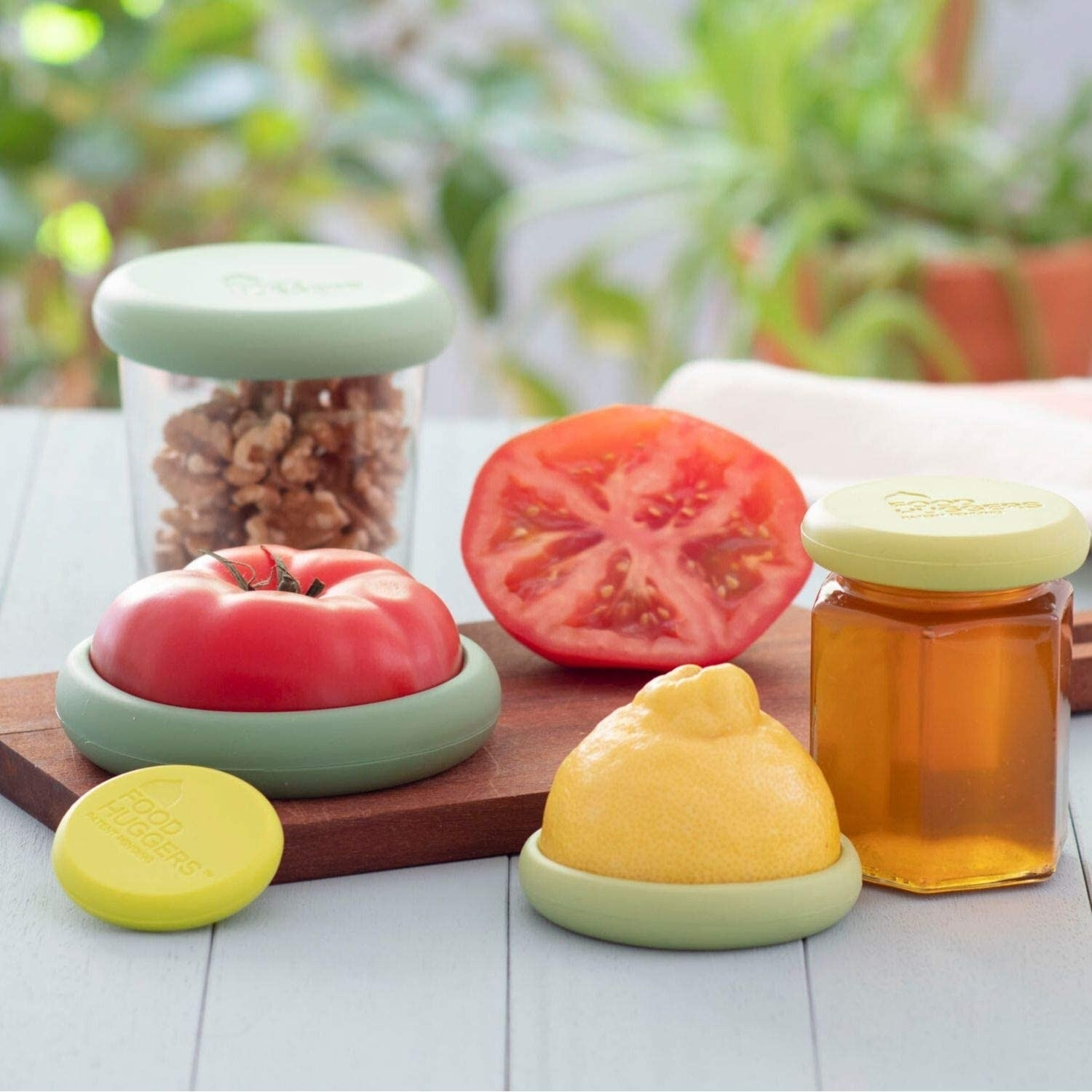 The huggers on different fruits and vegetables as well as open containers