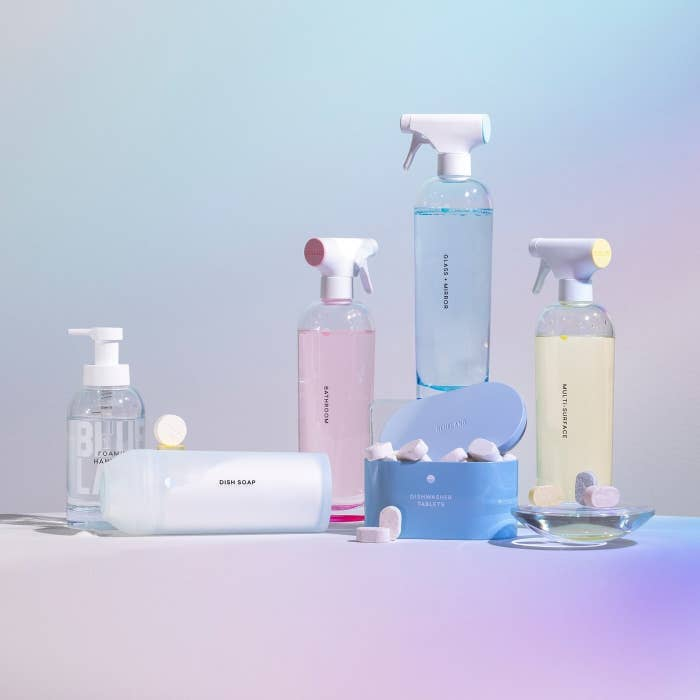 A product shot of the reusable spray bottles, tablets, and storage containers inside the kit