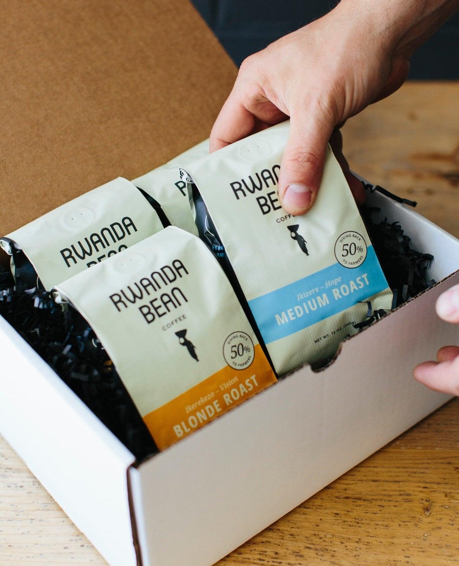 box full of four different bags of Rwanda bean coffee