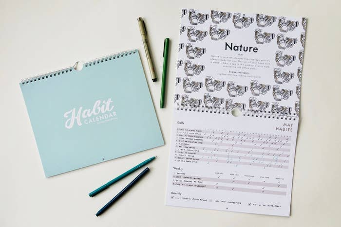 The habit calender, with a page open to the nature section with activities and days ticked off