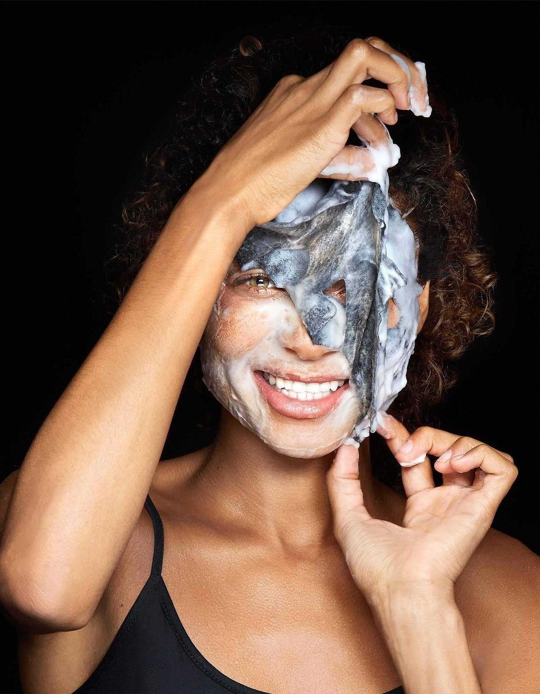 model taking off foaming face mask