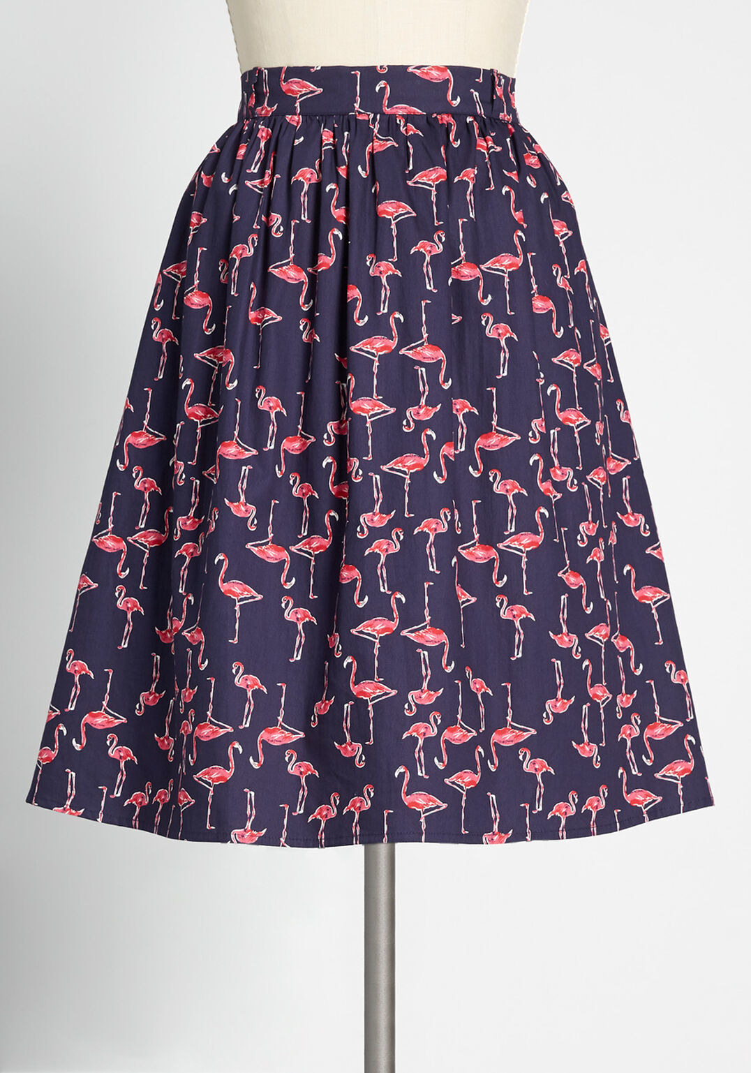 a navy blue skirt with an all-over flamingo patter