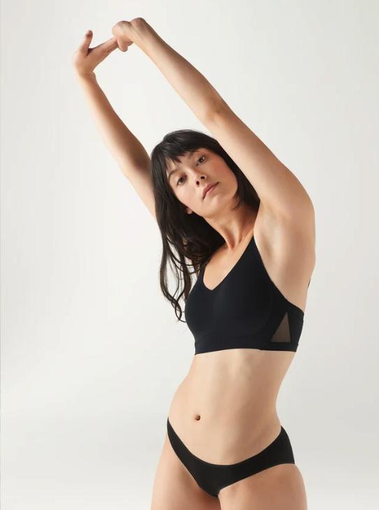 Model wearing the bra in black