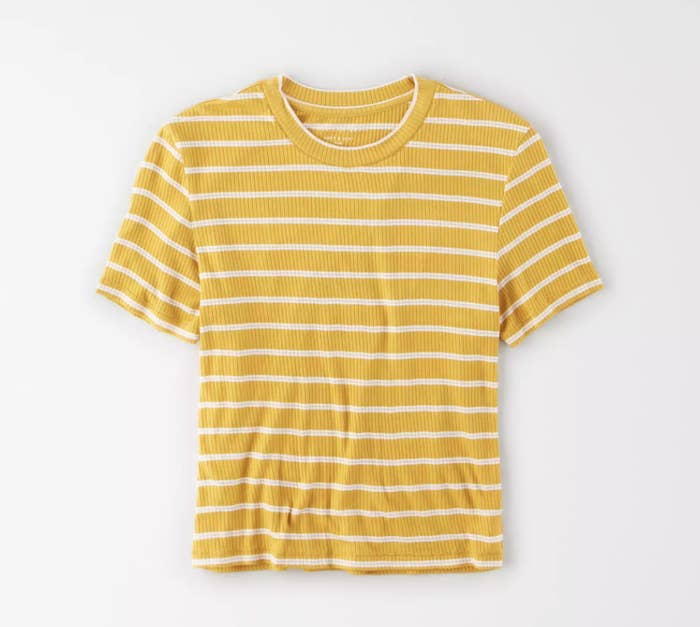a yellow shirt with thin white stripes