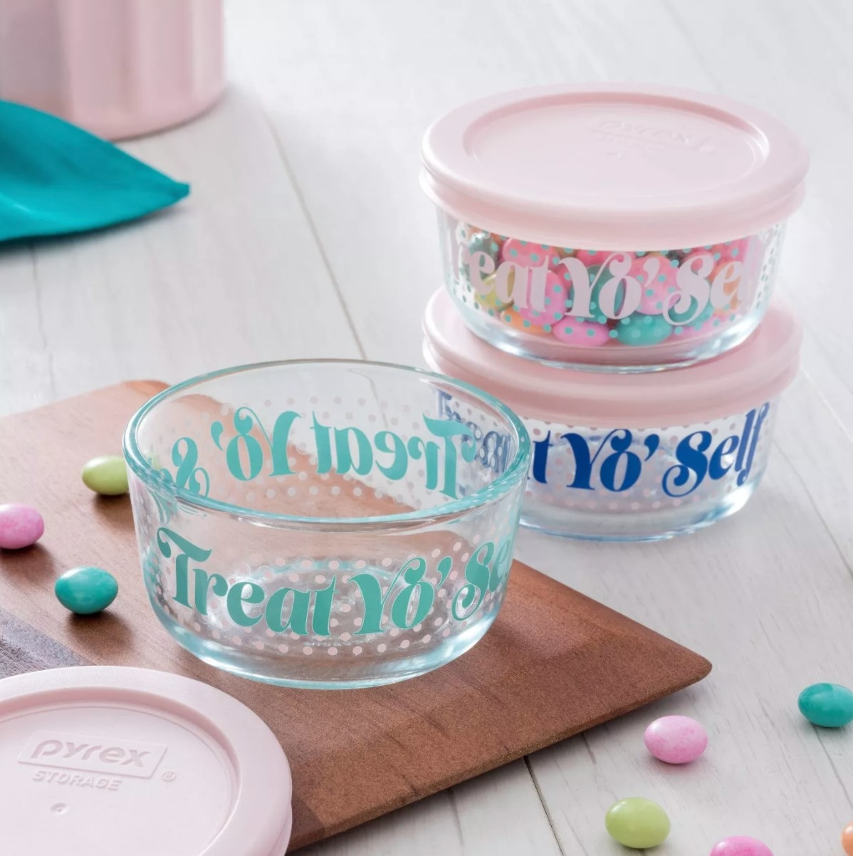 The bowls with pink or blue writing on the sides and pink lids