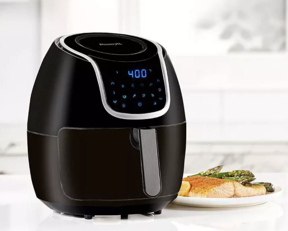 A black air fryer with a digital control panel with cooking settings
