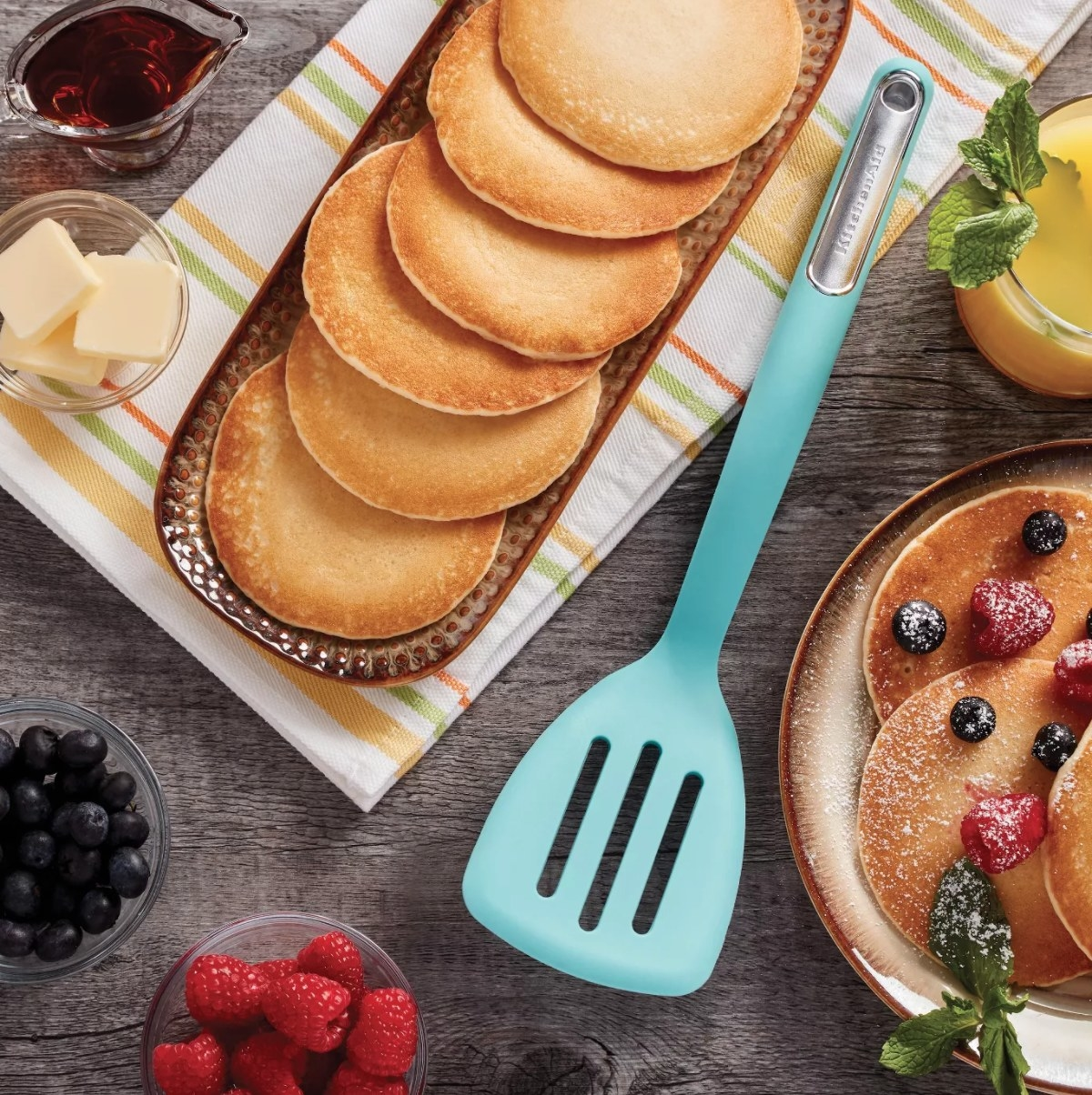 The blue spatula next to a stack of pancakes