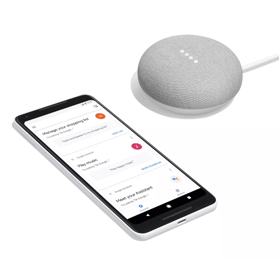 A round Google Home mini next to an iPhone app that helps control it