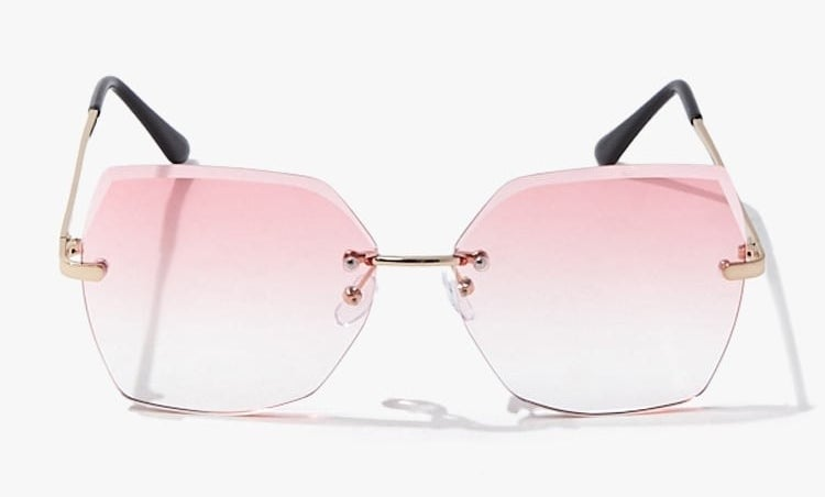 The sunglasses, which have pink gradient lenses