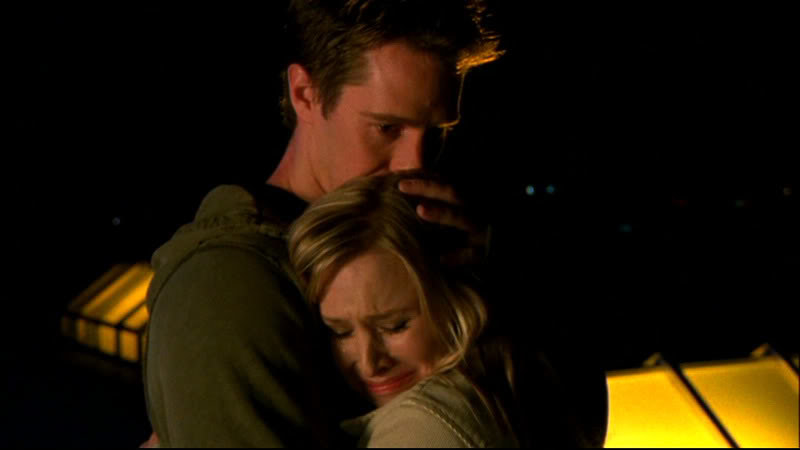 Logan holds Veronica as she cries into his arms