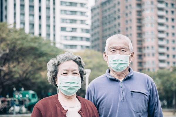 Photo of an elderly couple wearing face masks