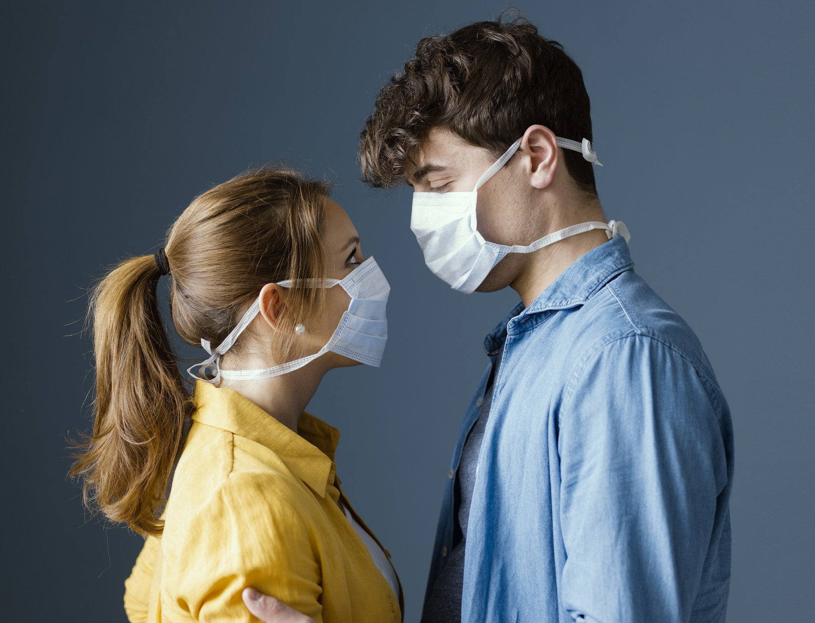 Photo of a couple wearing face masks