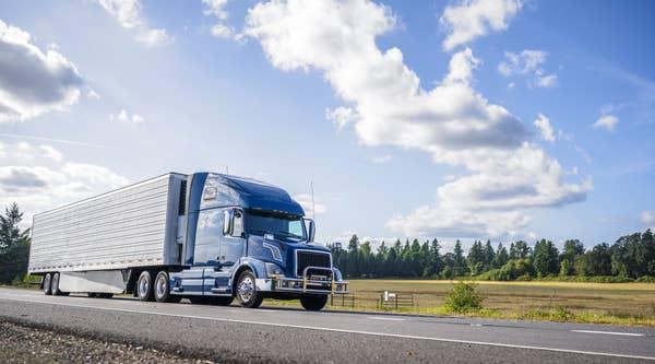 Photo of a truck speeding down a highway