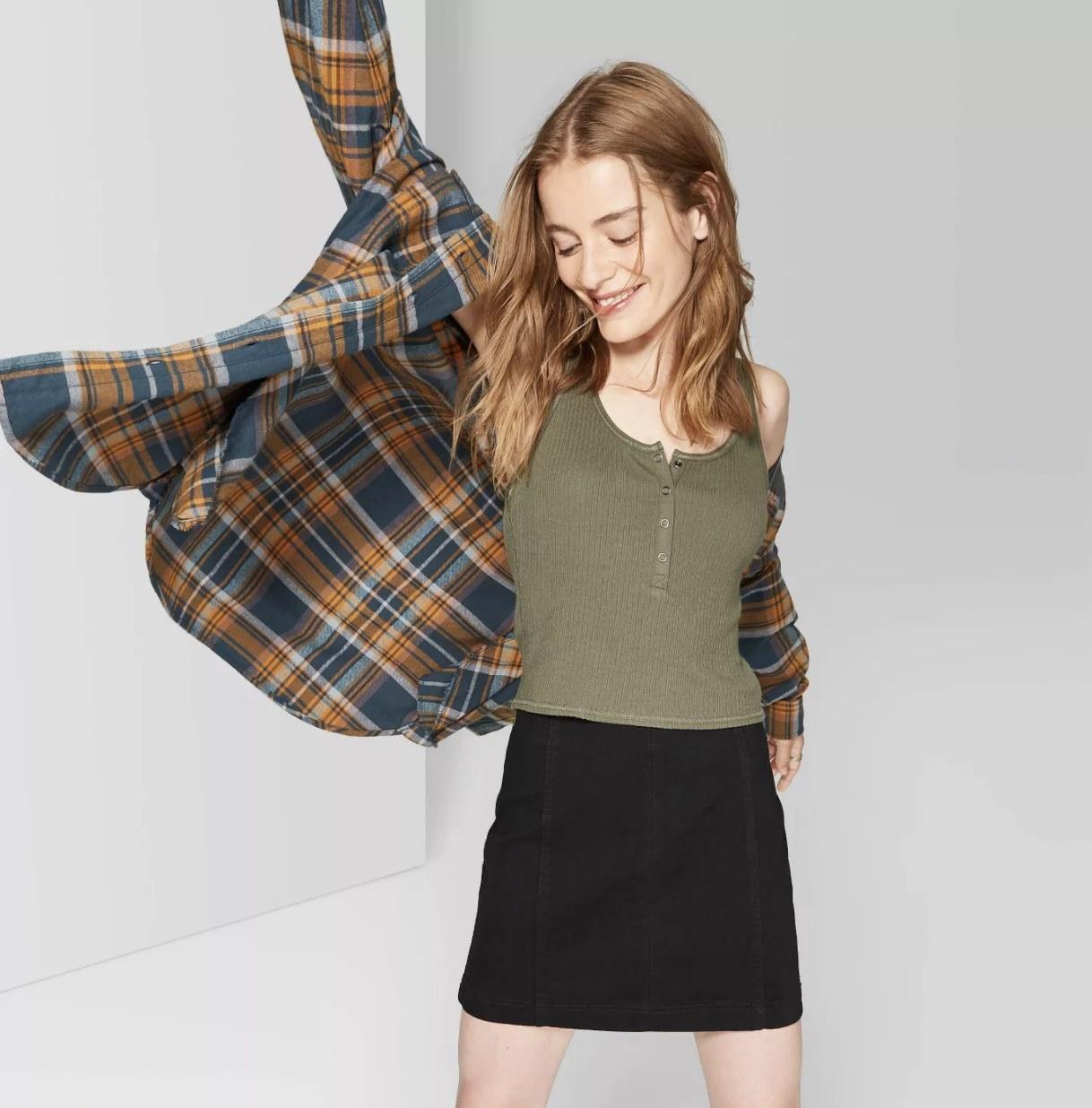 A model in the black skirt