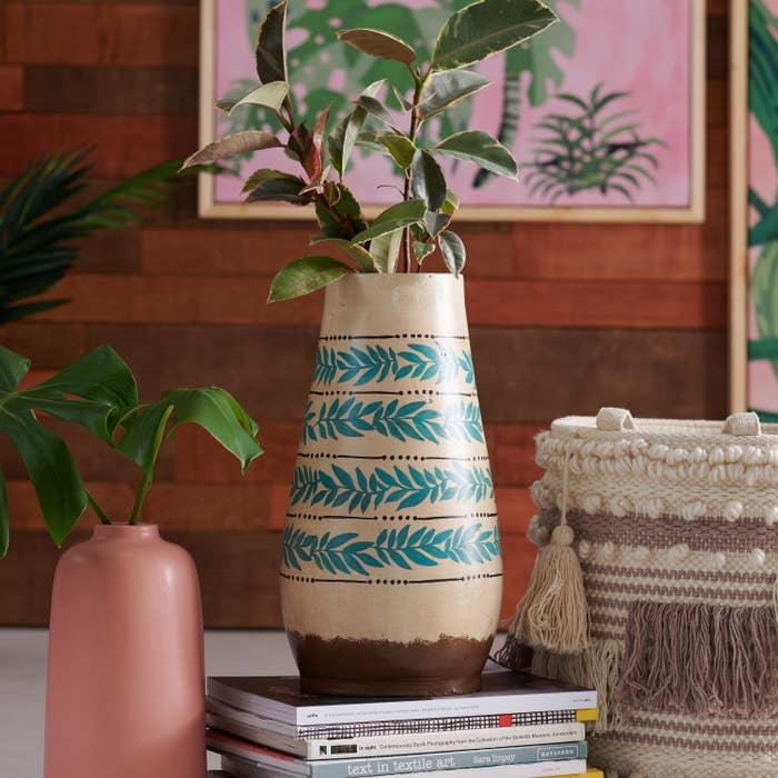 A beige vase with leaf patterns