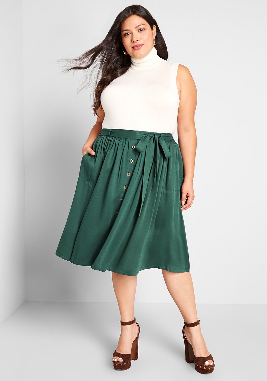 model wearing green tie waist midi skirt