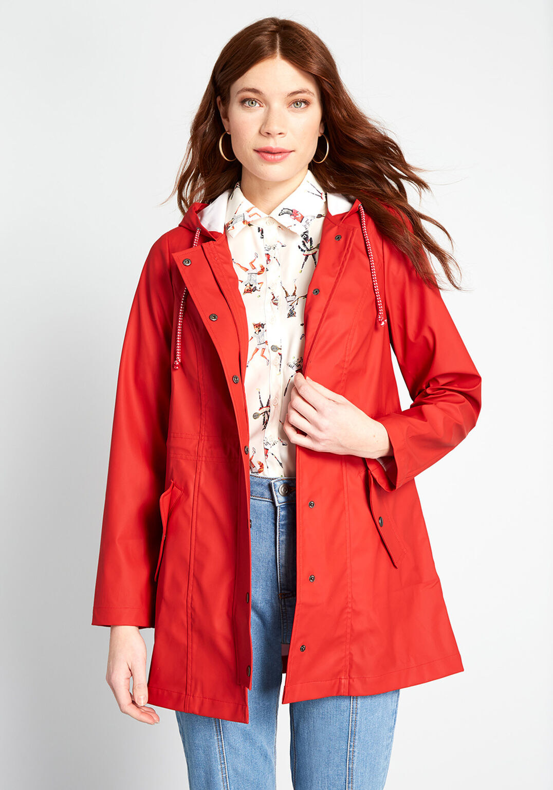 model wearing the midi length red coat