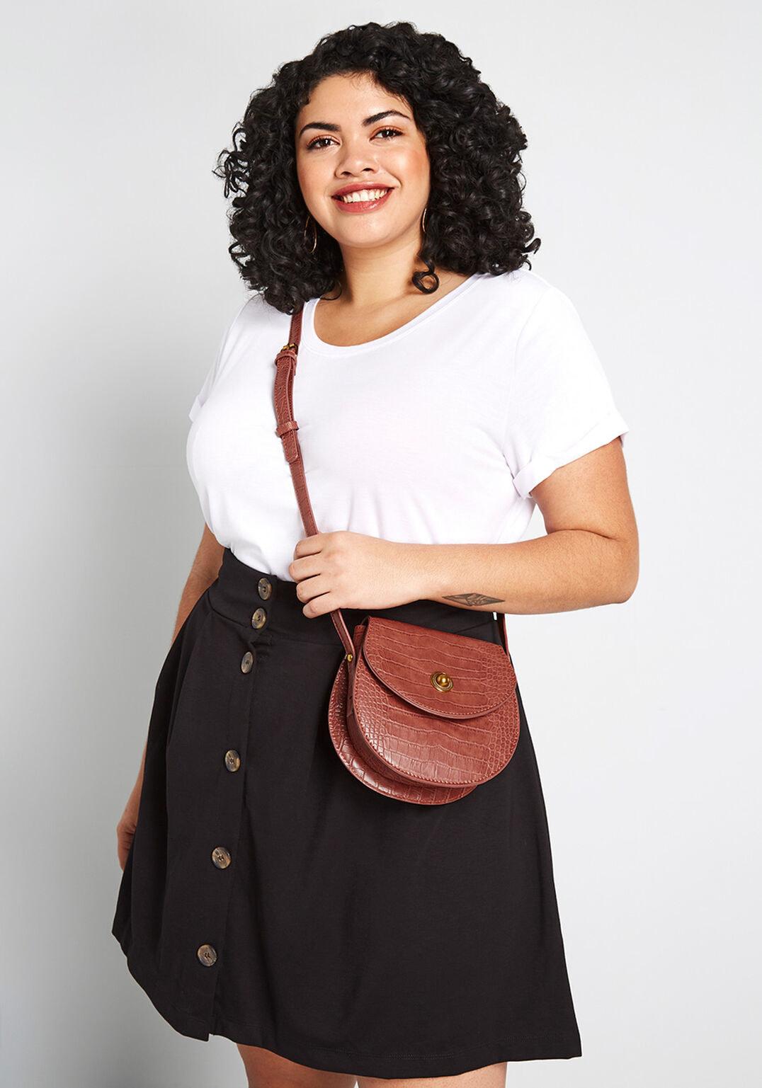 model wearing the brown crocodile pattern purse