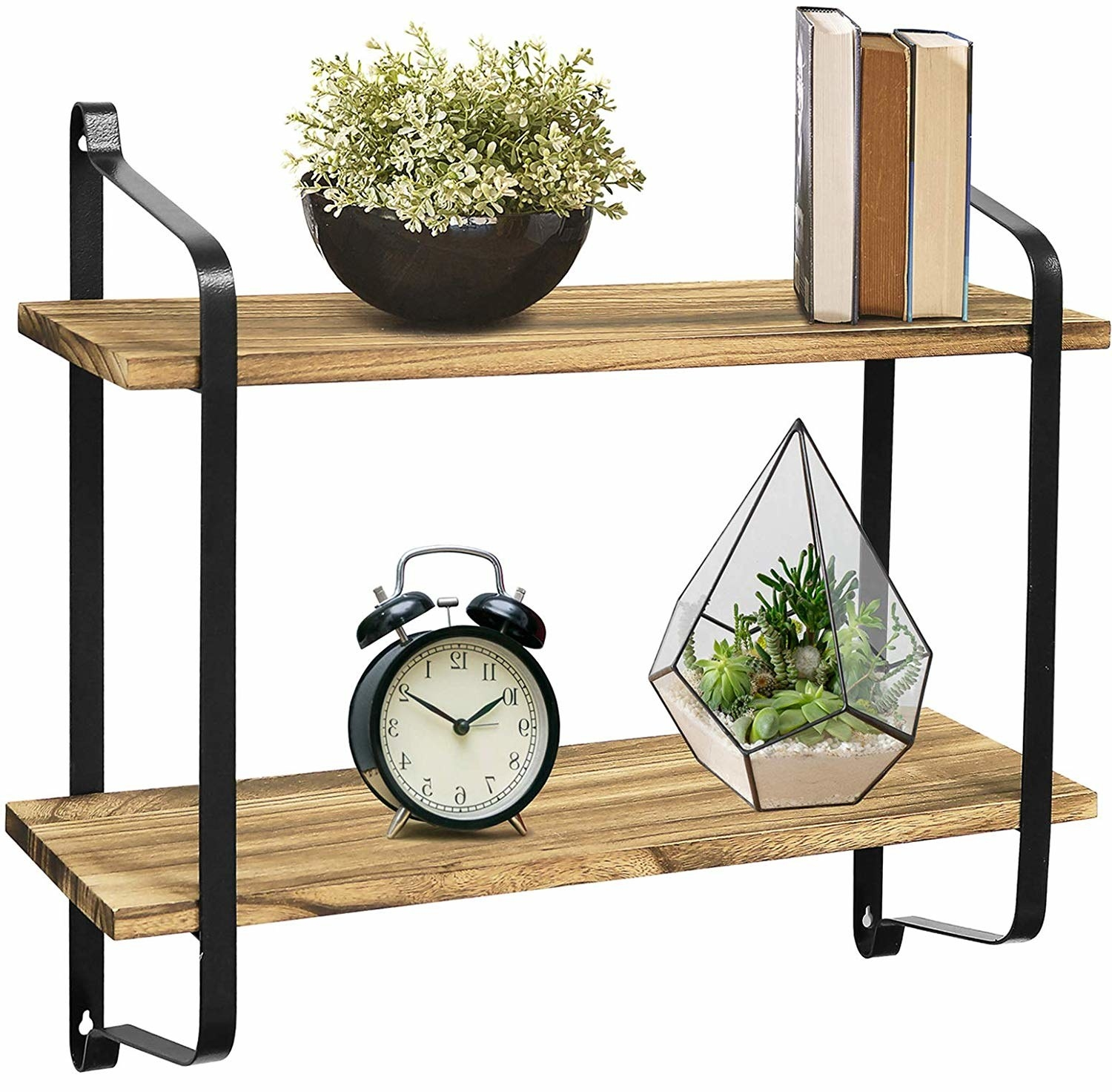 The wall shelf with objects propped on it