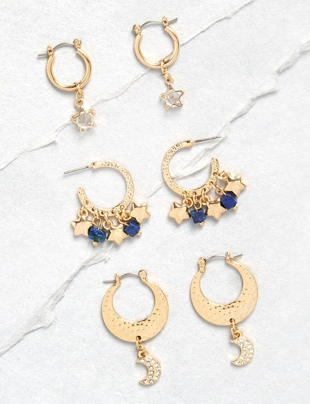 three pairs of faux gold earrings