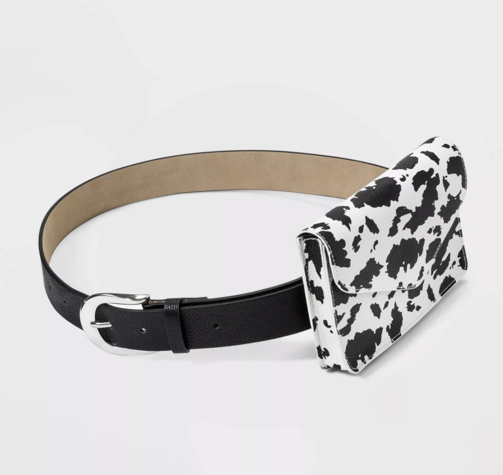 a black belt with a silver buckle and a cow print envelope-like bag attached