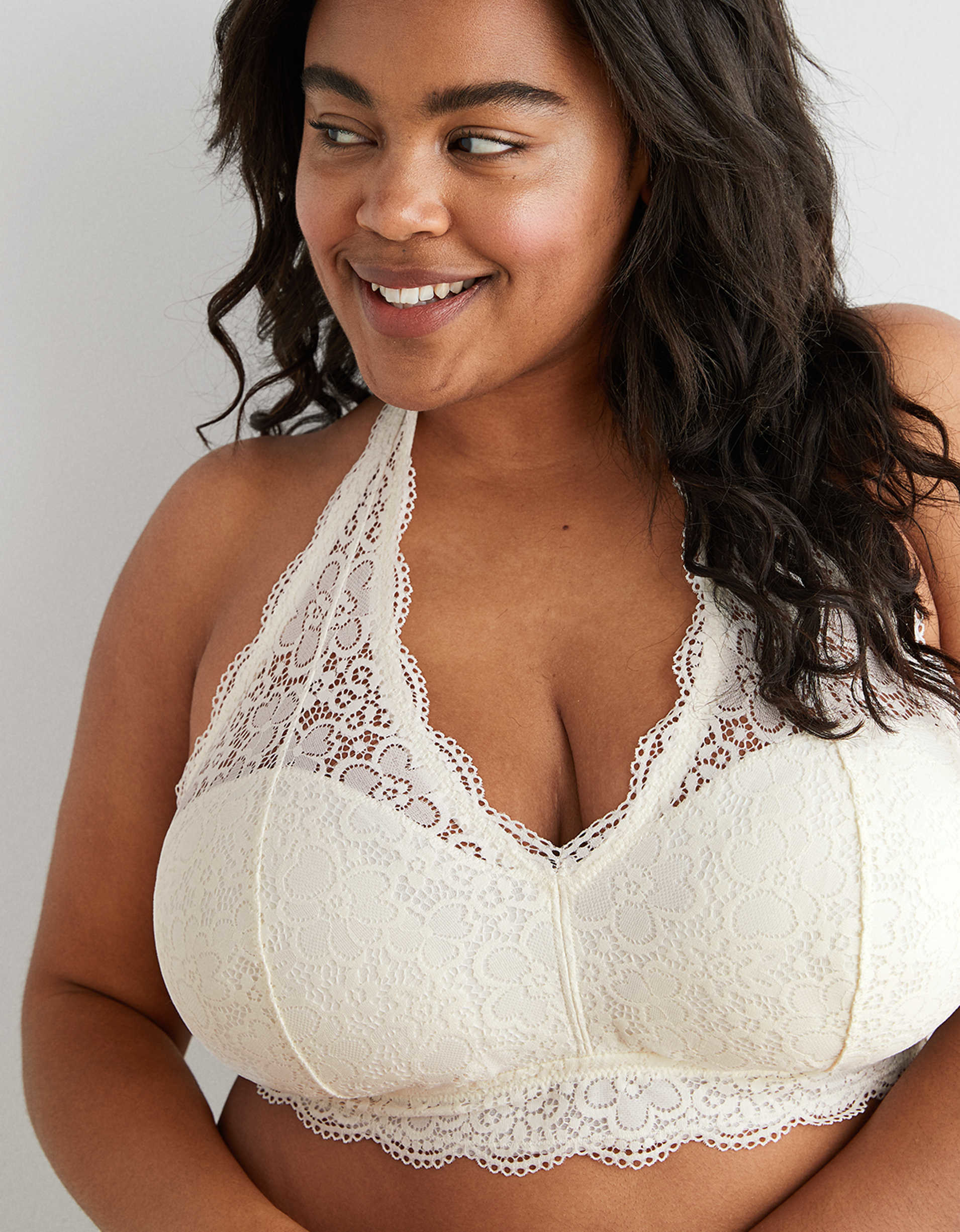 model in off white lace later bralette with full coverage on cups
