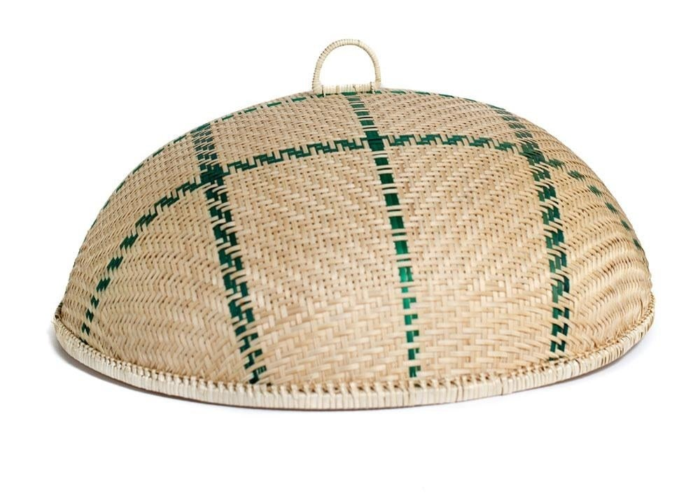 basket-like dome with green woven accents with a loop on top for easy placing and removal