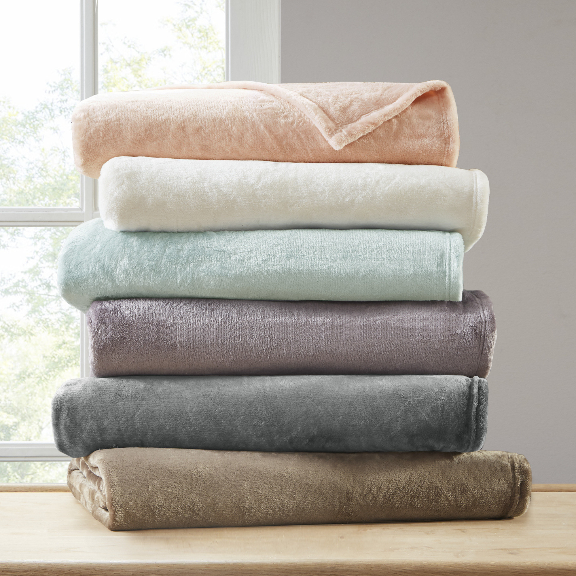 Stacked blankets in various colors