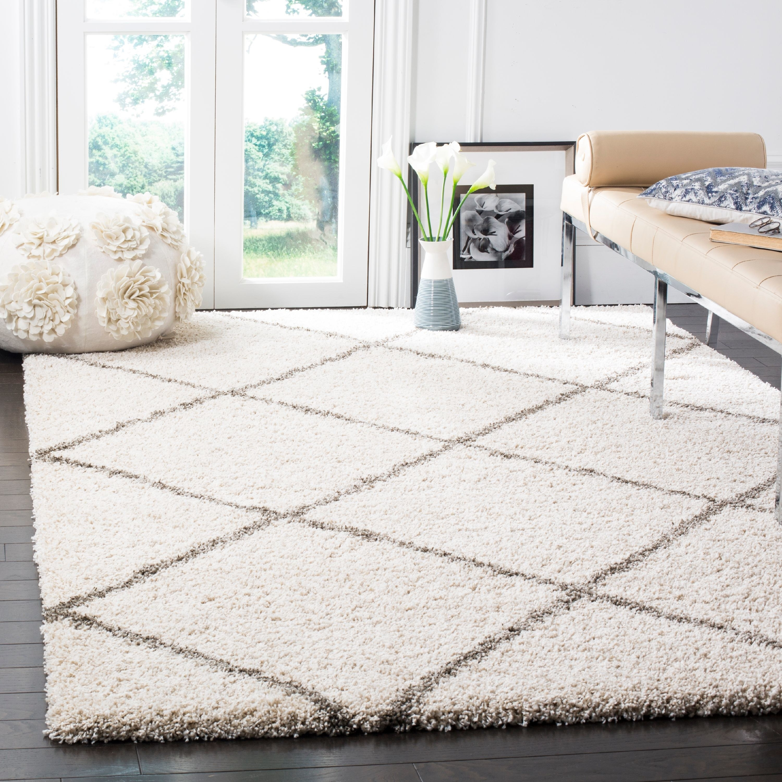 A white rug with gray crossed lines